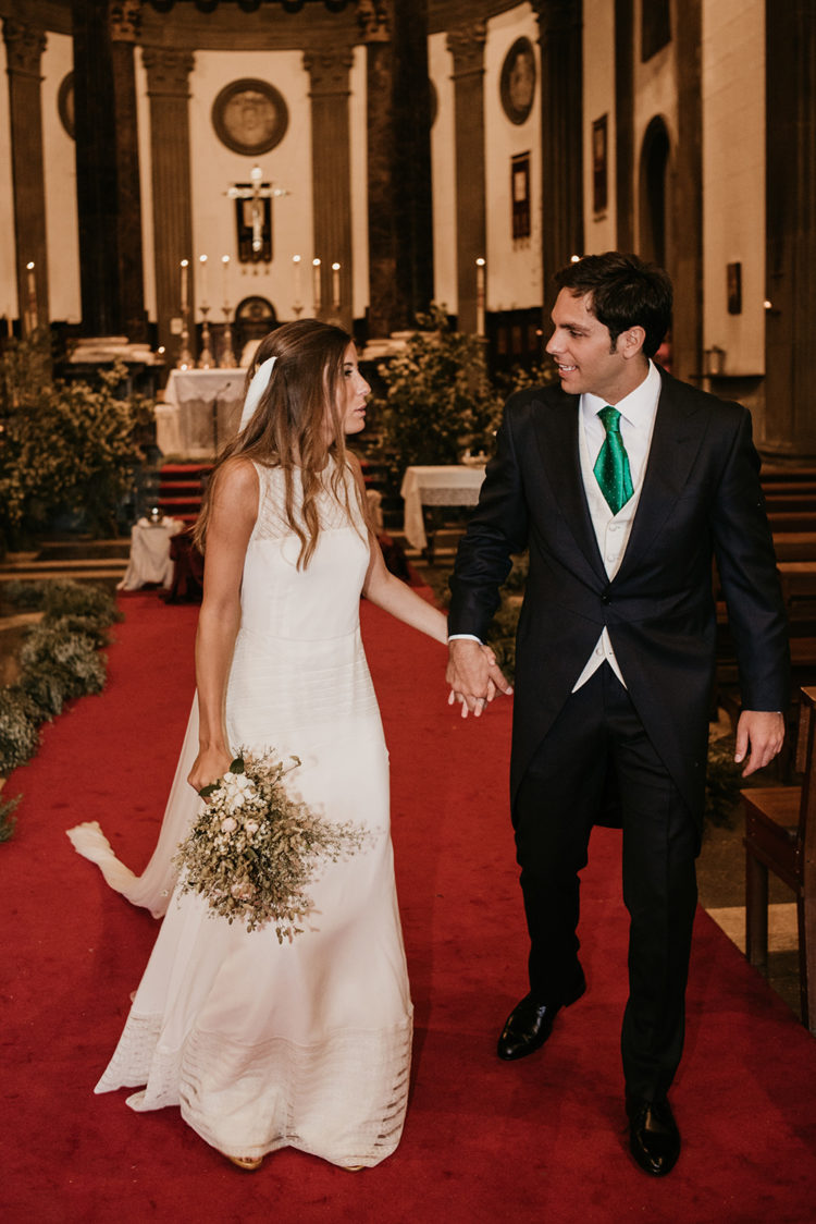 The groom was rocking a black morning suit with a creamy vest and an emerald tie