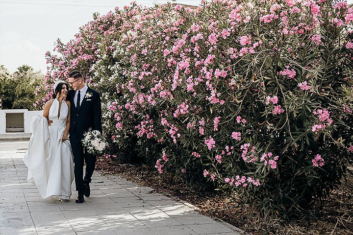The groom was wearing a black suit, a white shirt and a black tie for a classic feel