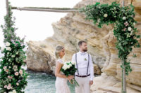 05 The wedding arch was a lush one, decorated with lush foliage and blush blooms