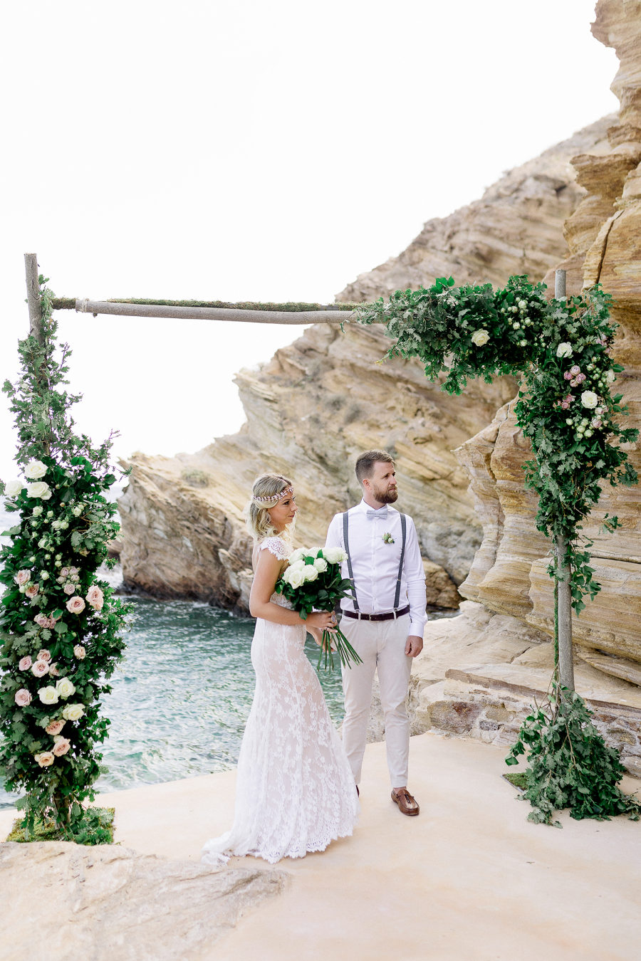 The wedding arch was a lush one, decorated with lush foliage and blush blooms