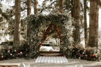 05 The wedding arch was of greenery, burgundy florals, and lush greenery all around added a woodsy pop