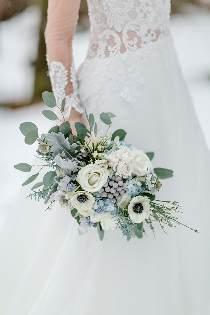 The wedding bouquet was done with white, grey and blue blooms and pale greenery