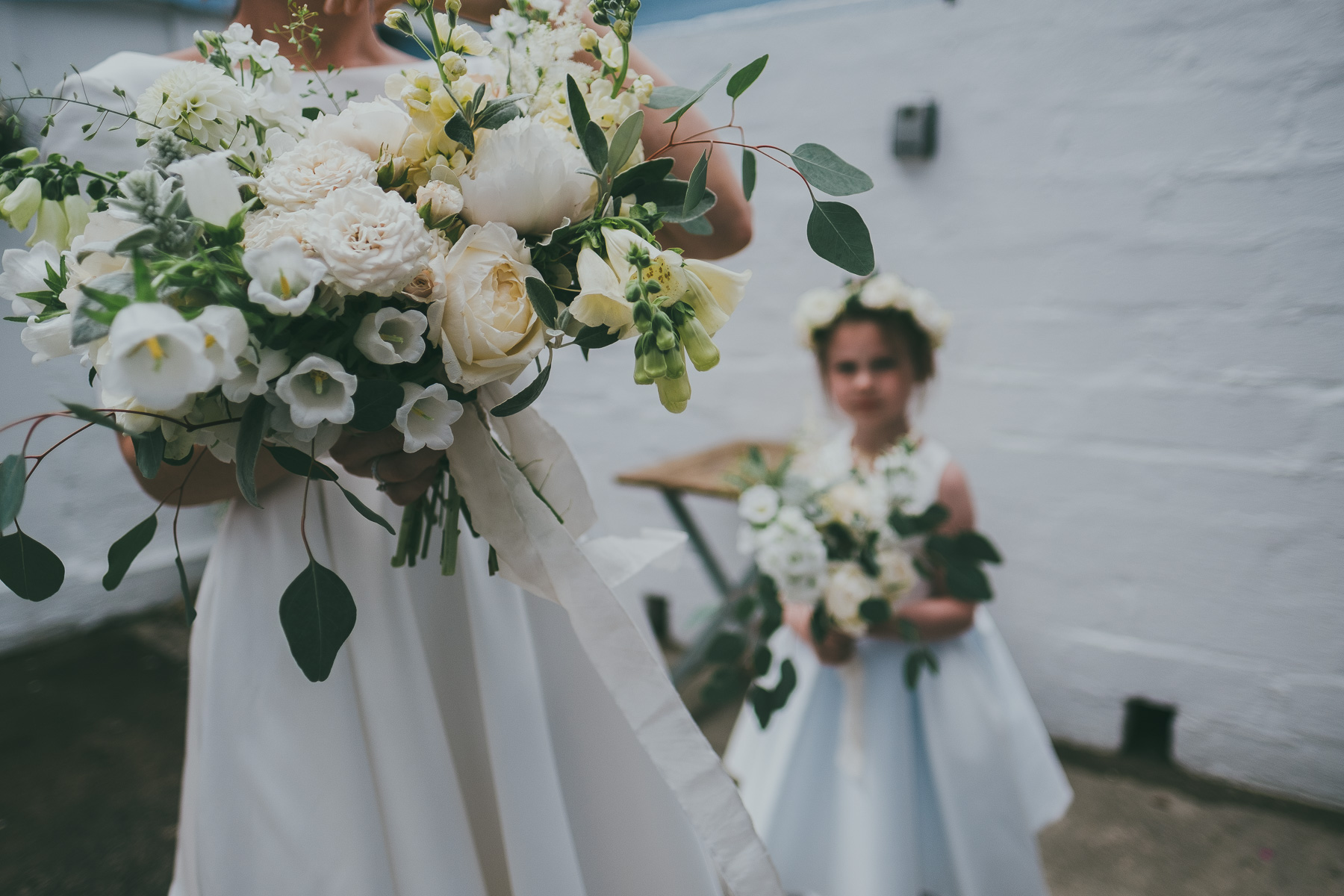 The wedding bouquets were done in neutrals, with blush blooms and greenery