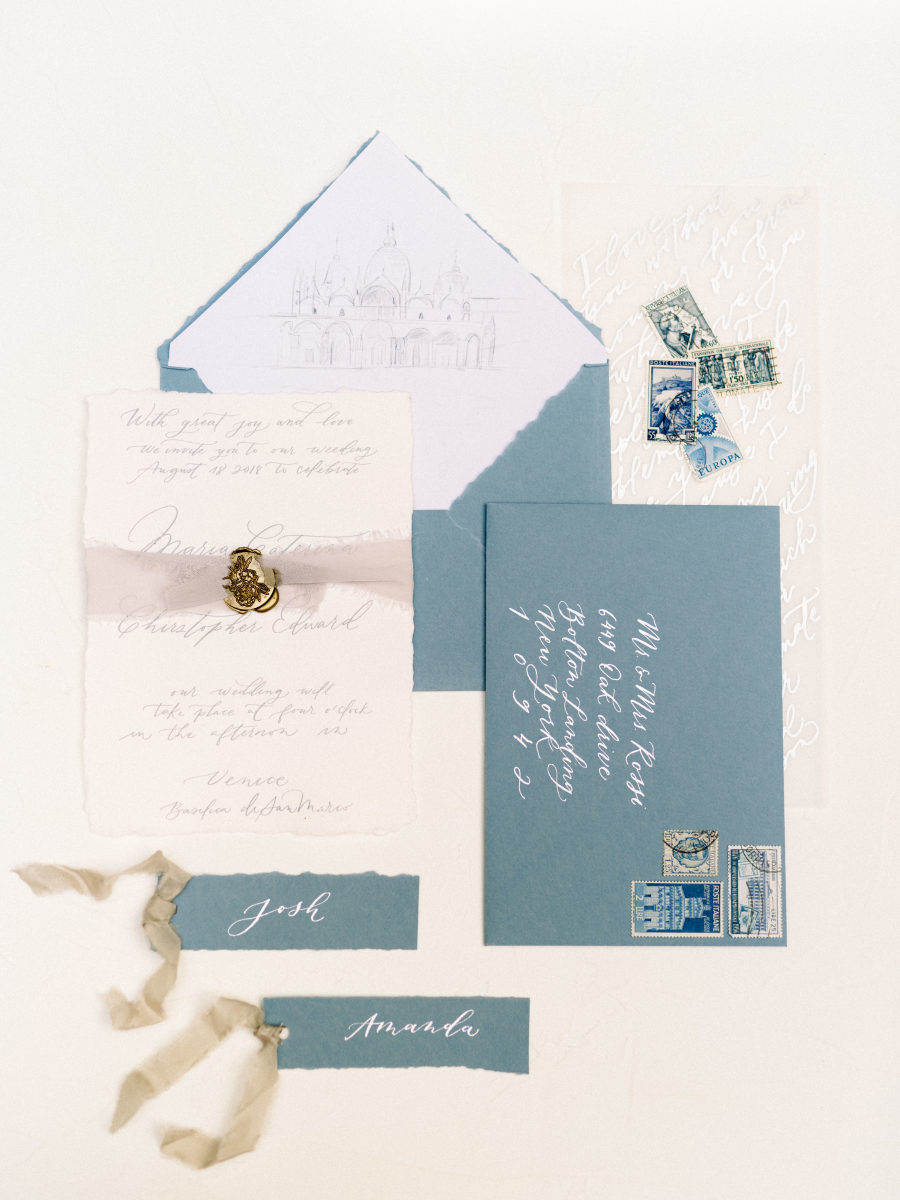 The wedding stationery suite was done in blues and dove greys with refiend detailing