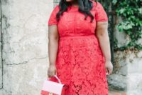 05 a coral lace midi dress with a high neckline, short sleeves and heels, a little bag