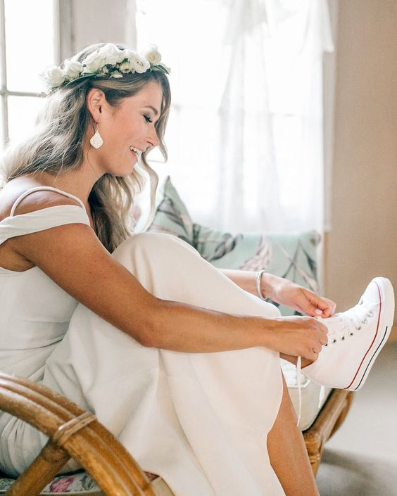 a modern bride wearing Converse wedge sneakersso that she could dance all night long