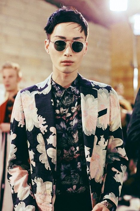 a moody floral suit and a moody floral shirt with a different print yet in the same colors
