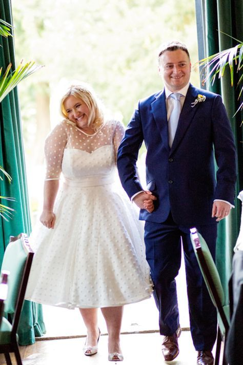 a tea-length polka dot A-line wedding dress with long sleeves, an illusion strapless neckline and peep toe shoes