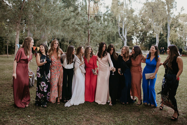 The bridesmaids were all wearing mismatching outfits including plain and floral gowns