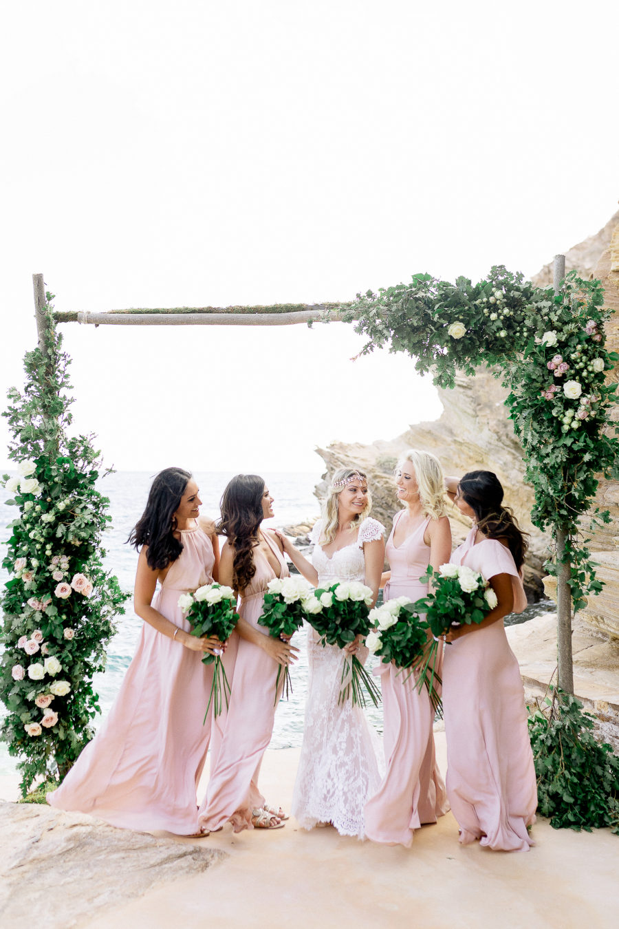 summer bridesmaids outfits in blush dresses