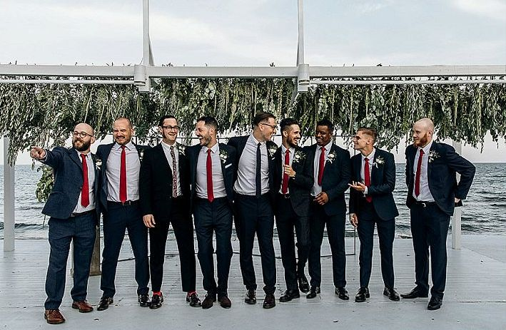 The groomsmen were rocking graphite grey suits with red ties