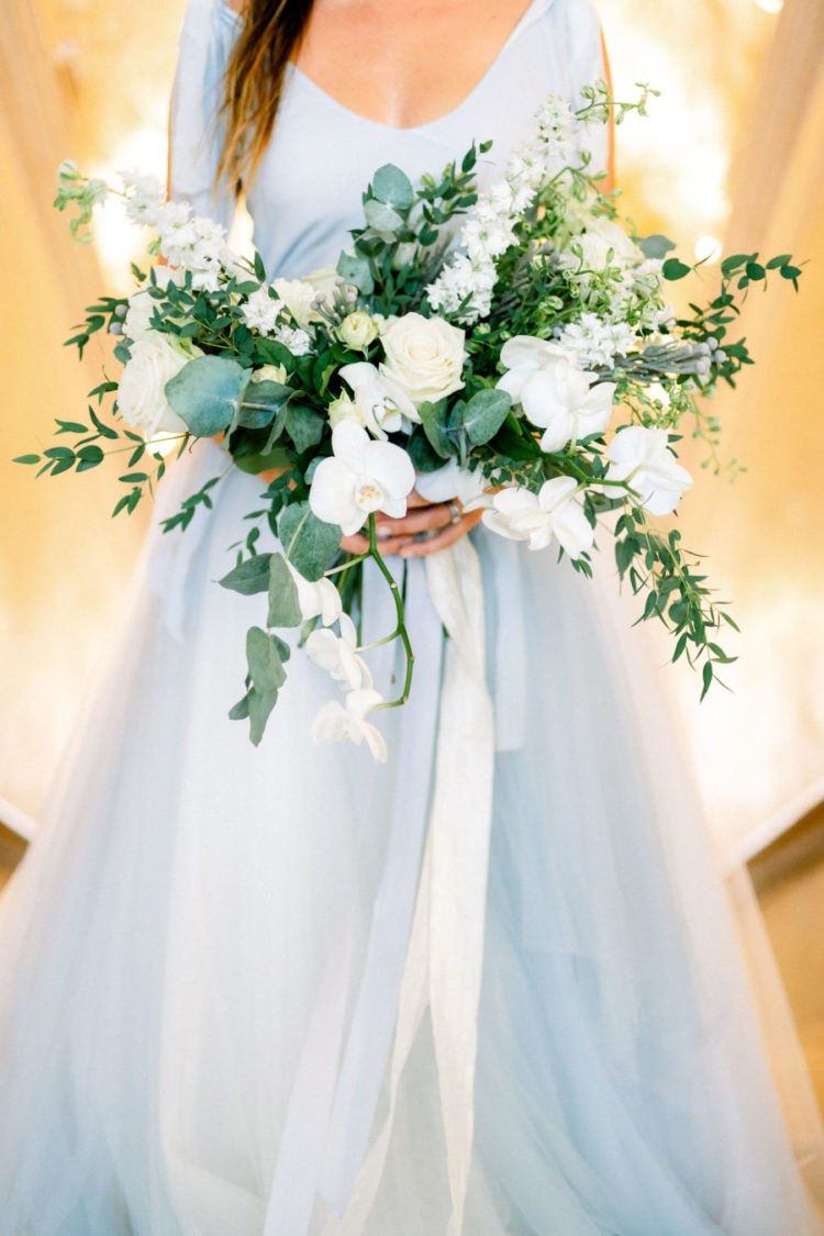 The wedding bouquet was done with white blooms and much greenery