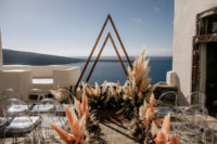 trendy triangle arch is a great choice even for a destination wedding