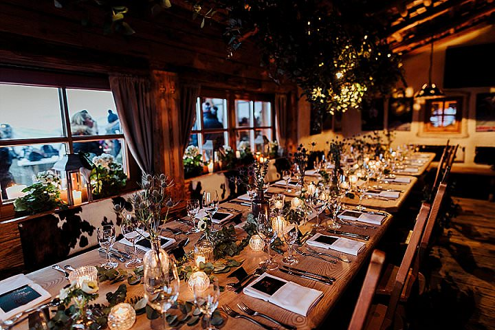 The wedding reception was was extremely cozy, rustic and welcoming, with candle lanterns and much greenery
