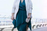 06 a dark green wrap midi dress with an asymmetrical skirt, a white blazer, a metallic clutch and shoes