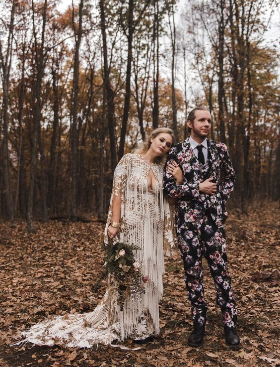 a moody floral print three piece wedding suit, a black tie and a white shirt, black shoes