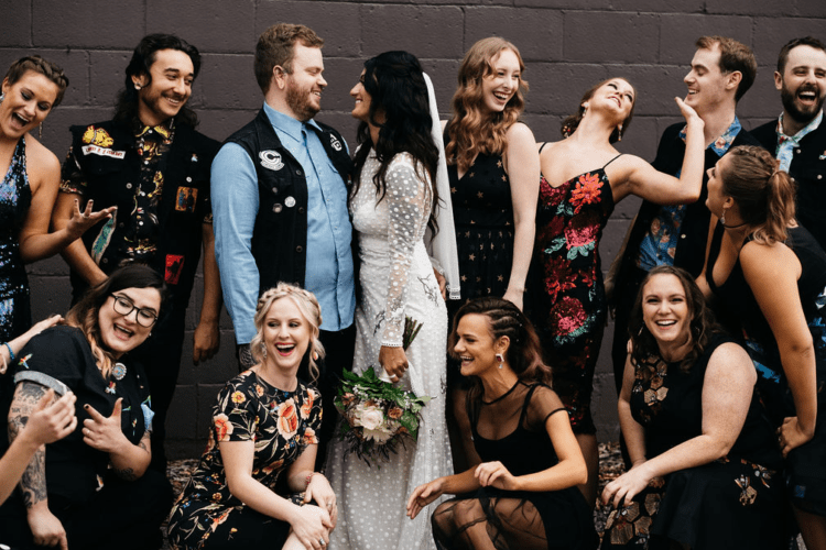 The bridesmaids and groomsmen were wearing self-selected eclectic attire for a bright and unique look