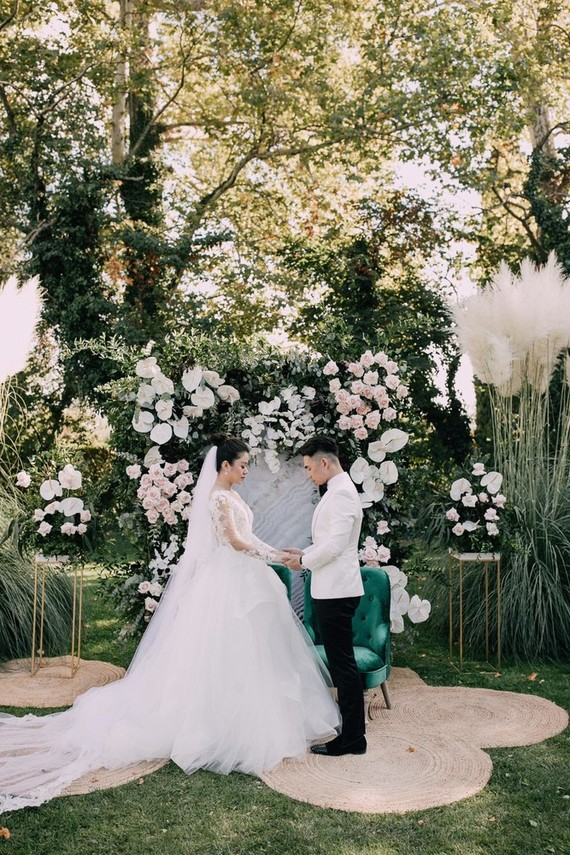 The ceremony space was done with a lush floral arch decorated with white and blush blooms and greenery