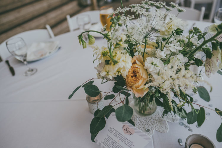 The wedding reception tables were all neutral, with neutral blooms and glasses