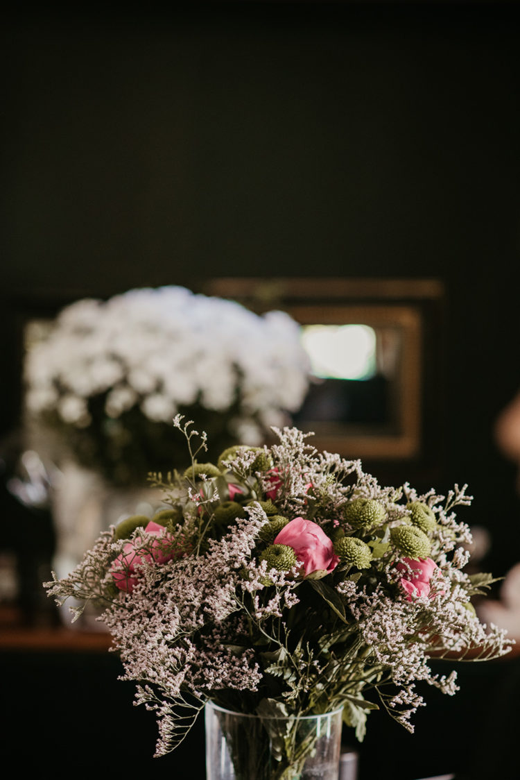 The wedding bouquet was cute and simple, done in green, blush and hot pink