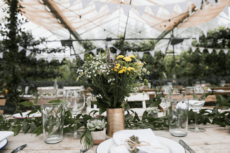 The wedding decor was mostly DIY, with much greenery, blooms and rustic and boho touches