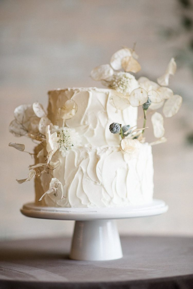 a gorgeous textural wedding cake done with lunaria is ideal for a spring wedding or if you want a refined touch