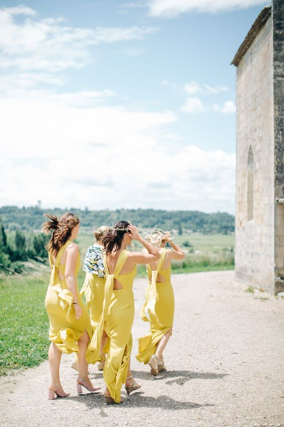 gorgeous bright yellow maxi bridesmaid dresses with side slits and catchy tie up backs