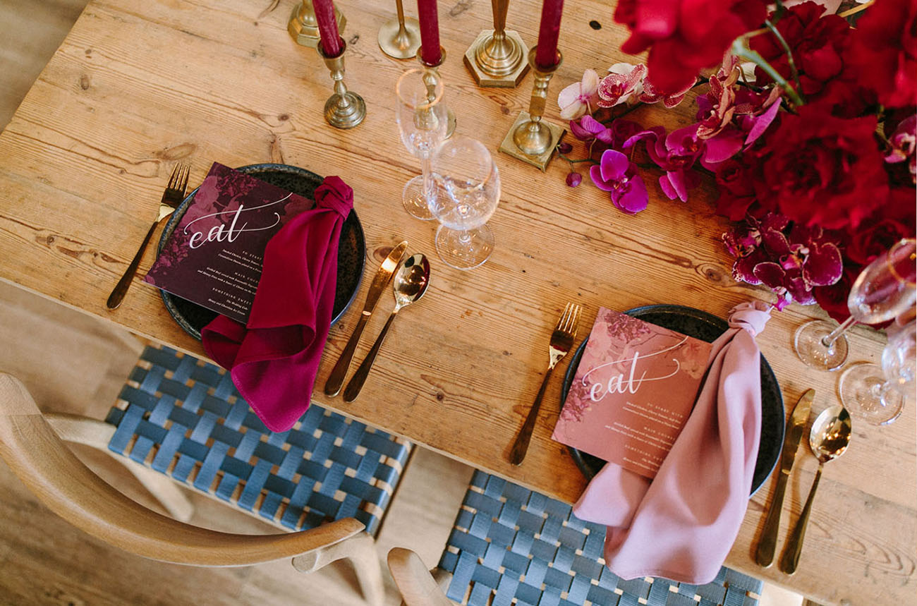 Colorful candles and pink and plum stationery and napkins finished off the table setting