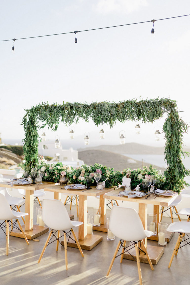 The reception also featured sea views, there was a lush greenery overhead decoration and a table runner dotted with pink blooms