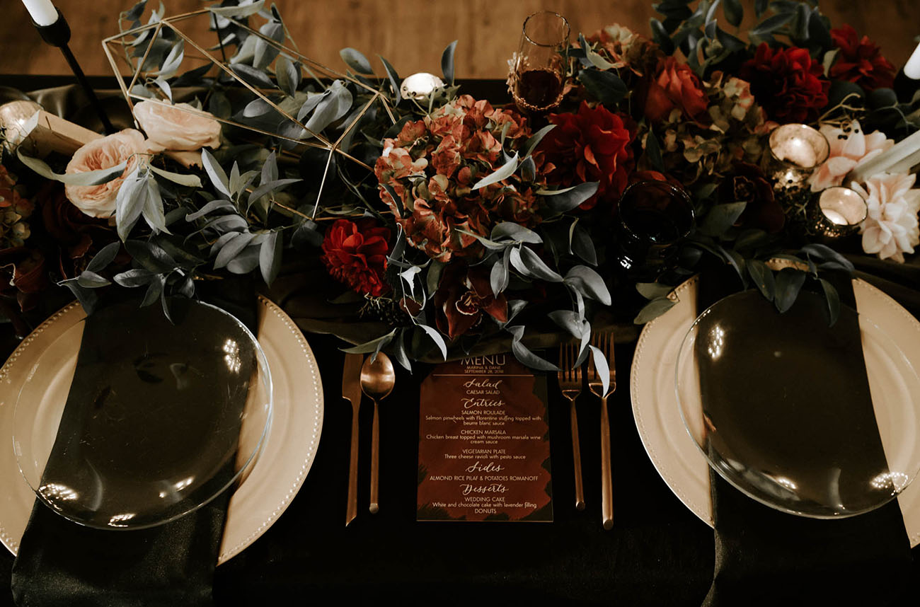 The wedding reception was done in black, burgundy, gold and blush with an elegant and refined feel