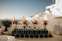 The wedding reception was done with a dark green tablecloth, lush pampas grass and bloom centerpieces