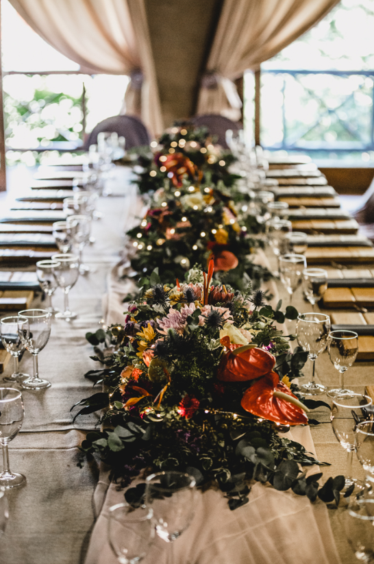 The wedding reception was neutral, with lush blooms and greenery used for centerpieces