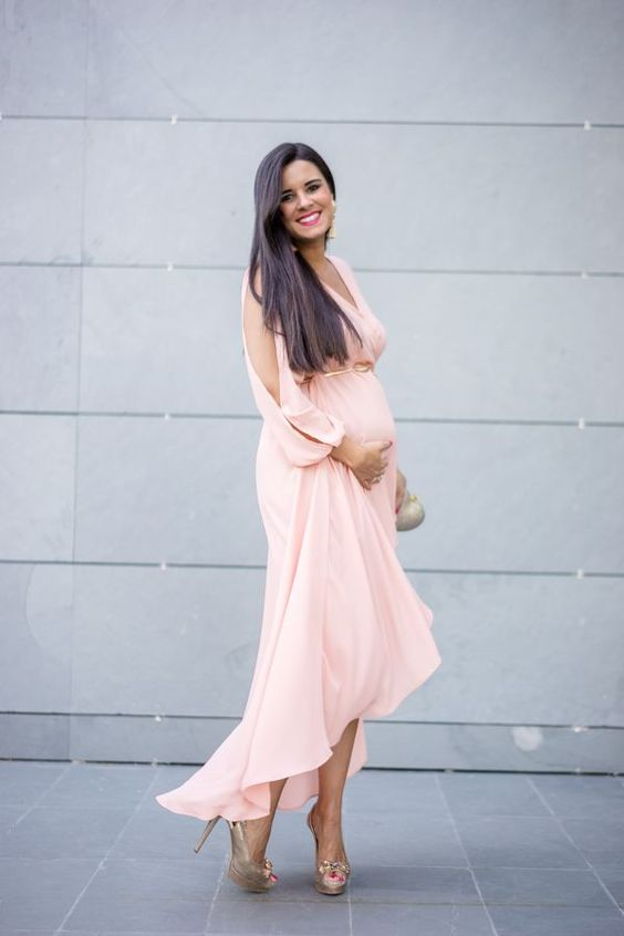 a blush wrap dress with an asymmetrical skirt, long sleeves, embellished shoes and tassel earrings
