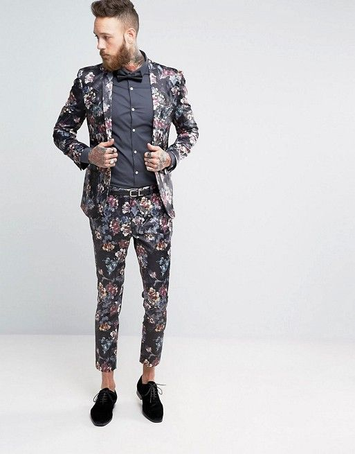 a moody floral suit with skinny cropped pants, a graphite grey shirt, a black bow tie and black suede shoes