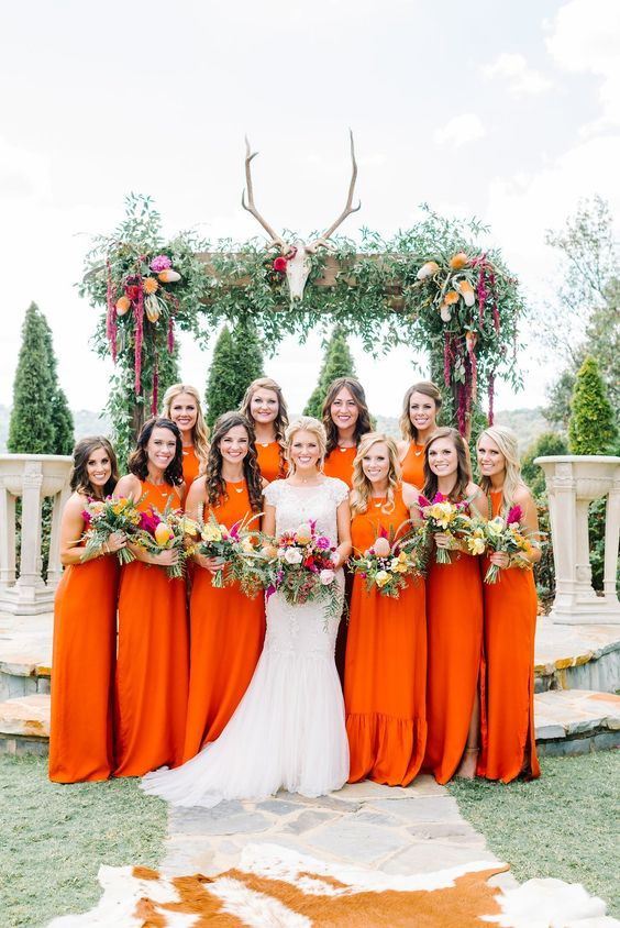 bold orange maxi bridesmaid dresses with no sleeves and halter necklines look amazing