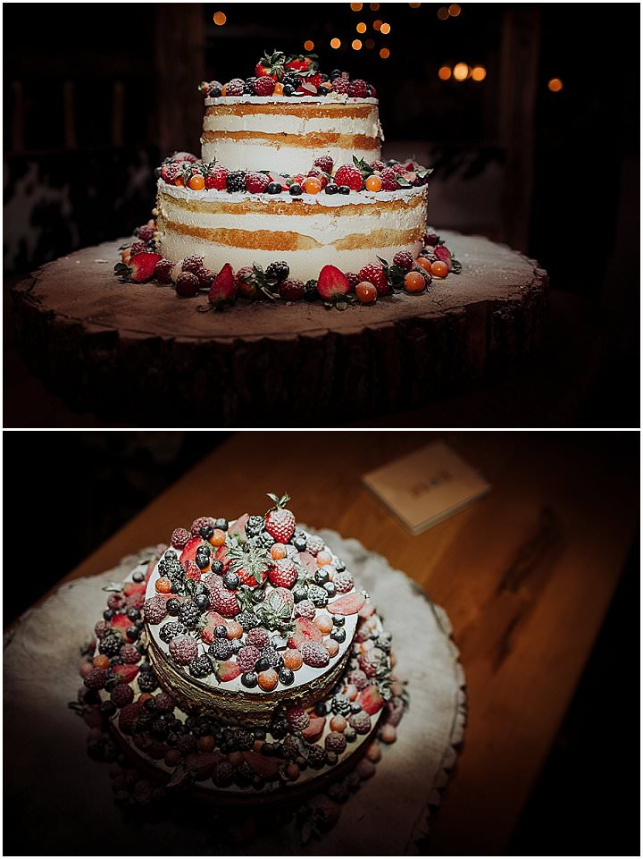 The wedding cake was a naked one with fresh berries and fruits