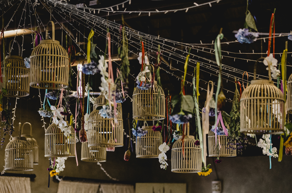 There were many faux birdcages hanging overhead and decorated with fresh blooms