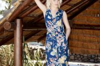 09 a bright navy maxi dress with a floral print, a front slit, a V-neckline and no sleeves brings a vintage feel