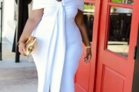 09 a gorgeous off the shoulder white fitting miid dress with large ties, leopard shoes and a metallic clutch