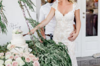 10 The wedding cake was served on a swing with lush greenery and blush blooms