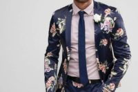 10 a navy suit with a pink floral tie, a blush shirt, a navy tie for an edgy badass groom's look