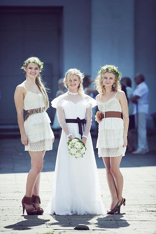 a vintage-inspired polka dot maxi wedding dress with a ruffled neckline, long sleeves and a black silk sash