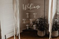 10 an acrylic seating chart decorated with ribbons and lunaria branches looks very chic and catchy