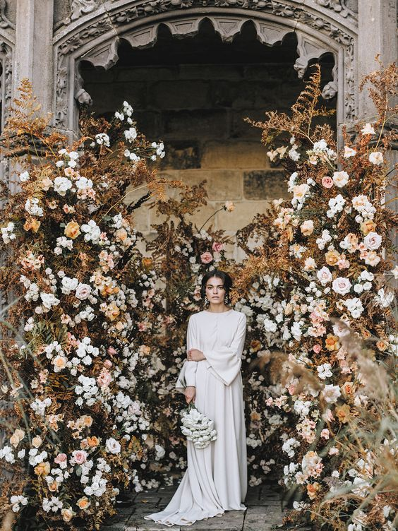 a jaw dropping floral wedding backdrop done with dried herbs is amazing for a fall wedding