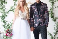 11 a stylish modern groom's outfit with black pants and a shirt, black shoes and a moody floral blazer