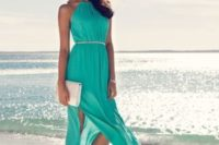 11 turquoise maxi dress with a halter neckline, side slits, sandals and a small white clutch