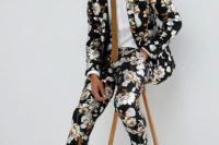 12 a moody floral suit, a white shirt, a brown tie that matches the print and black moccasins