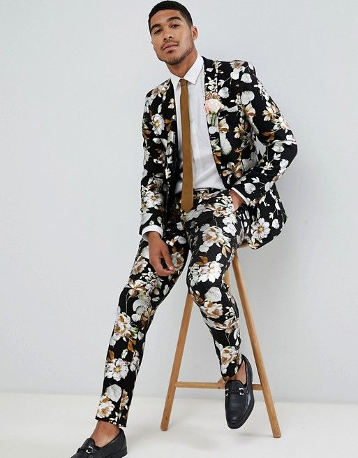 a moody floral suit, a white shirt, a brown tie that matches the print and black moccasins