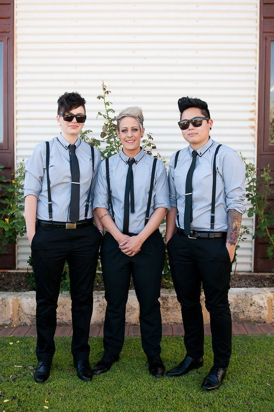 groomsladies wearing black pants, grey shirts, black suspenders and ties look cool and relaxed