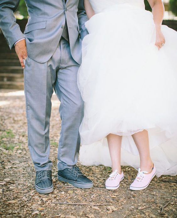 Vans shoes for both, grey ones for the groom and blush ones for the bride for a cute touch